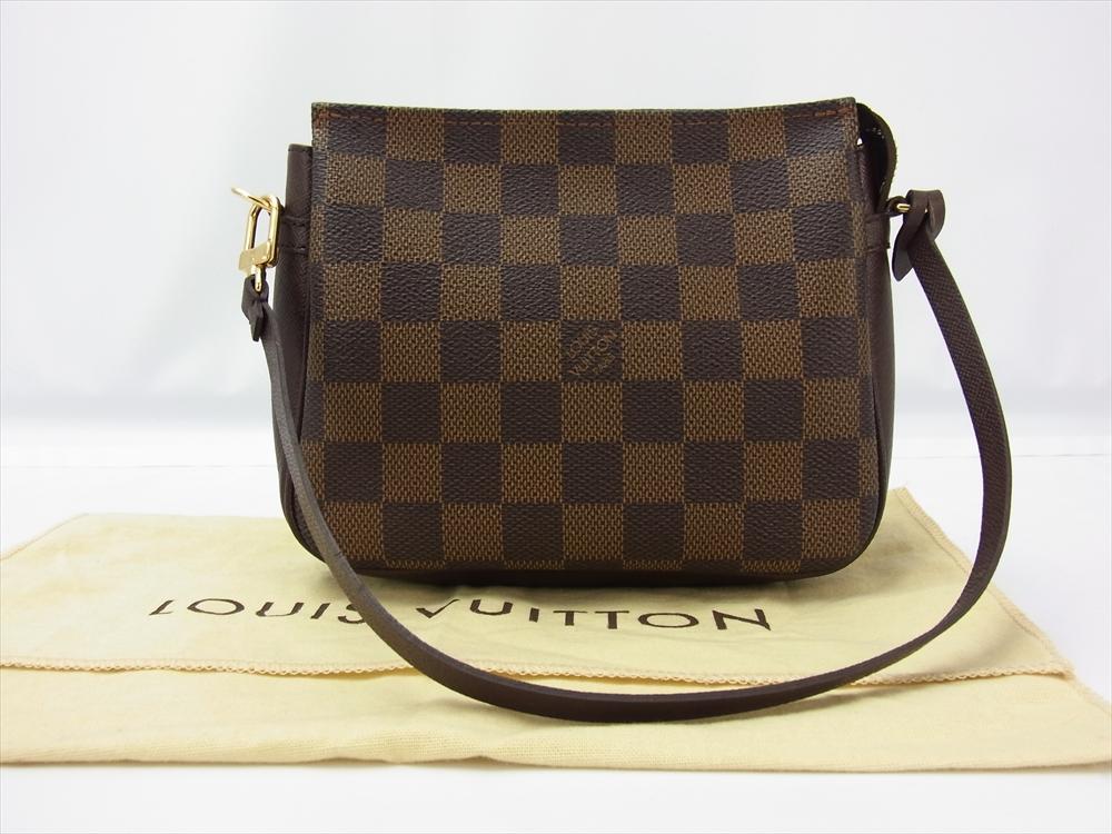 0b801f52ec59 Louis Vuitton Trousse Damier Ebene Pochette Handbag - Luxurylana Boutique